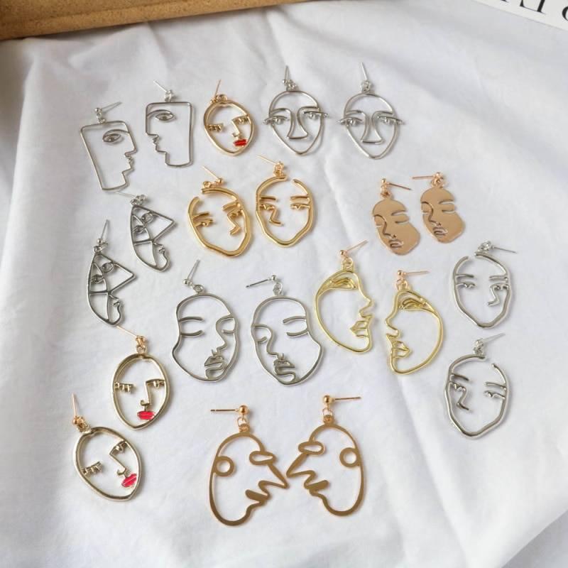 Retro punk human face drop earrings