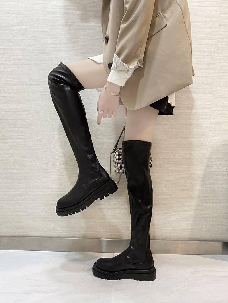 Black flat over the knee platform boots